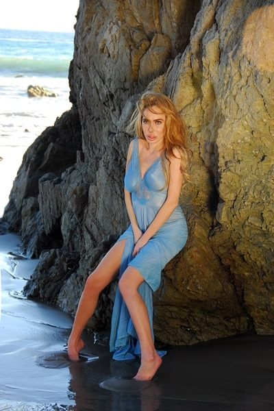 Annabella Gutman in blue dress on the beach