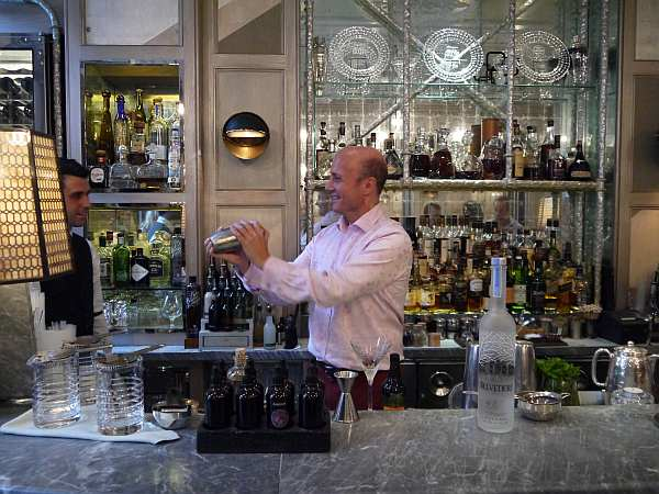 Gentlemans Butler shaking cocktails at the world famous Connaught Bar in Mayfair, London