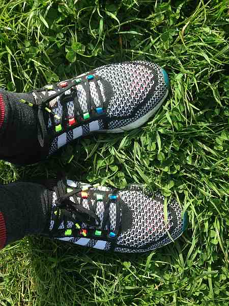 Adidas Cosmic Boost Shoes on the grass
