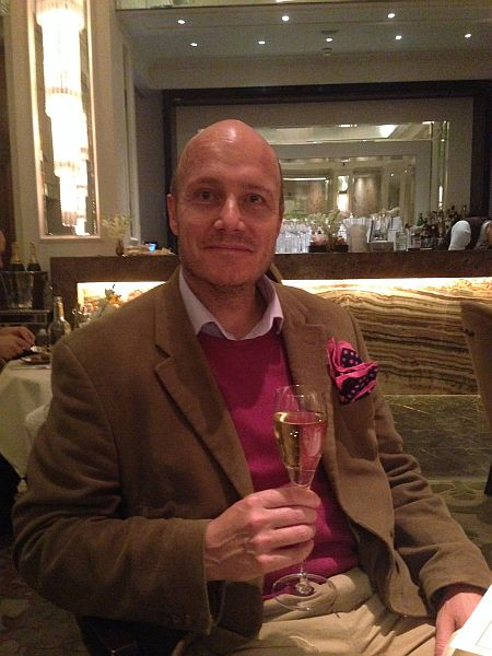 The Langham London Palm Court Luxury Restaurant - Michael Grenville enjoying a glass of champagne