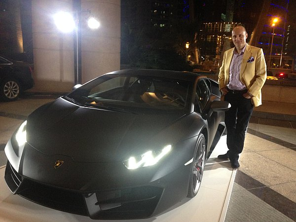 Michael Grenville wearing Stowers of savile Row with Wrangler & Ferrari cars outside the Four Seasons, Qatar