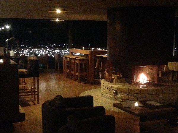 Bar, open fire and restaurant at The Crans Ambassador in Crans- Montana, Switzerland
