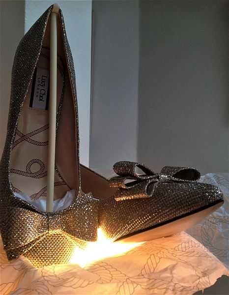 Lucy Choi London Luxury Shoes for Mother's Day - A pair of shoes glowing