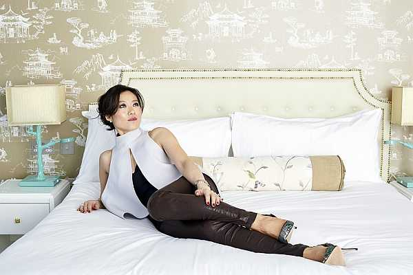 Lucy Choi London Luxury Shoes for Mother's Day - Lucy Choi reclining on a bed