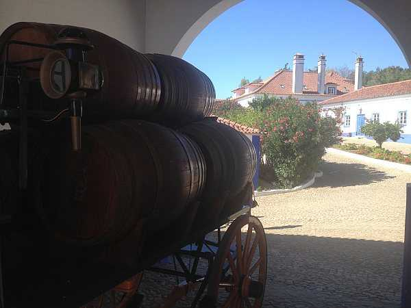 Travel to Portugal's Alentejo to experience rugged luxury - Herdade da Ravasqueira wine barrels on a cart