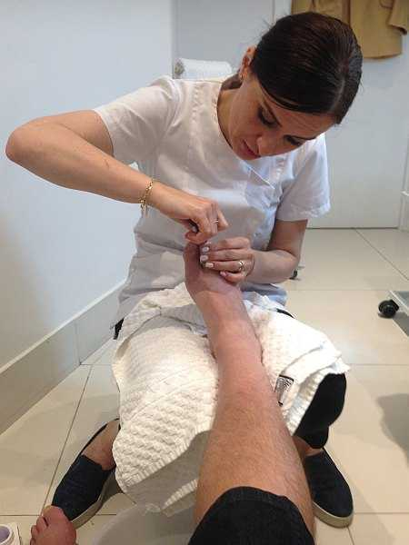 Mayfair beautician offering pure elegance - Alicia Janiec clipping toenails
