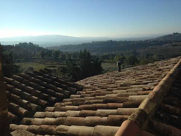 My beautiful love affair with Umbria - Castello di Monterone, looking over the rooftops on a sunny morning