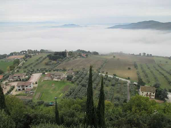 My beautiful love affair with Umbria - Looking down from Monte Castello di Vibio, seemingly floating on a sea of cloud