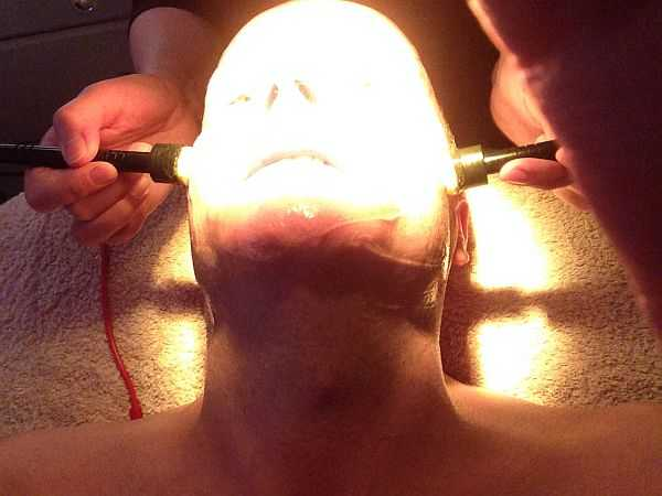 Luxury Knightsbridge Facialist Arezoo - warming up and pushing the goodness into the skin