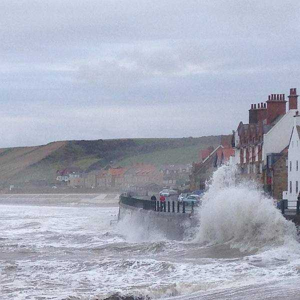 Five ladies and a Butler at The White Swan - The wild sea at Sansend near Whitby, Yorkshire