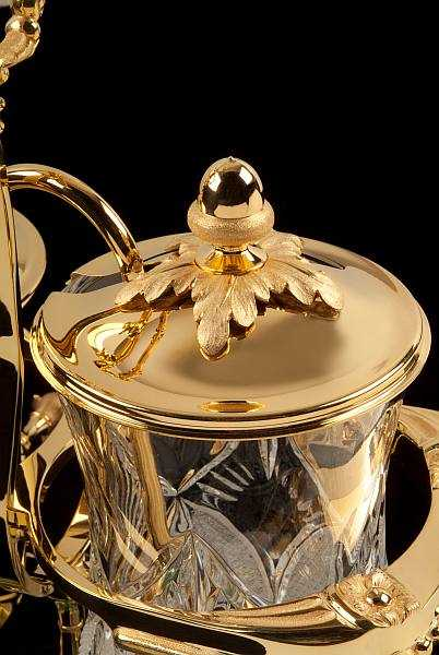 Royal Coffee Maker in gold & crystal for a lavish dinner party - Close Up of acorn against black